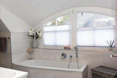 Badezimmer mit integrierter Sauna
